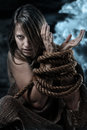 Wild woman with tied up hands Royalty Free Stock Photo