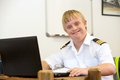 Portrait of young pilot with down syndrome at desk. Stock Image