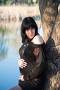 Portrait of a young pregnant girl the on walk in city park Stock Photos