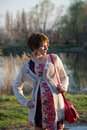 Portrait of a young pregnant girl the on walk in city park Royalty Free Stock Image
