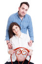 Portrait of young pregnant woman with husband behind her back women as happy family and marriage concept isolated on white Stock Images