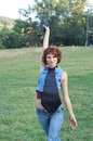 Portrait of a young pretty girl with gun on nature Stock Photo