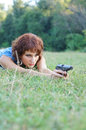 Portrait of a young pretty girl with gun on nature Royalty Free Stock Photo