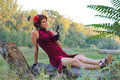 Portrait of a young pretty girl with gun on nature Royalty Free Stock Image