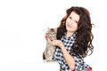 Portrait of a young pretty woman holding her lovely little cat isolated on a white background beautiful smiling brunette girl and Royalty Free Stock Photography