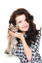 Portrait of a young pretty woman holding her lovely little cat isolated on a white background beautiful smiling brunette girl and Stock Image