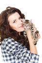 Portrait of a young pretty woman holding her lovely little cat isolated on a white background beautiful smiling brunette girl and Stock Photos
