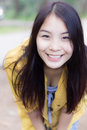 Portrait of a young pretty woman smiling outdoors photo form thai Royalty Free Stock Image
