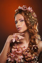 Portrait of a young redhead woman in beautiful flowers Royalty Free Stock Photo