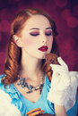 Portrait of a young redhead woman dressed as alice in wonderland video game Royalty Free Stock Images
