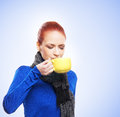 Portrait of a young redhead woman drinking tea and attractive caucasian from yellow cup the image is taken in studio on Stock Images