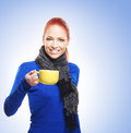 Portrait of a young redhead woman holding a cup Stock Images