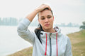 Portrait of a young sad woman with headache, fatigue or cold. D Royalty Free Stock Photo