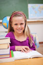 Portrait of young schoolgirl reading a book Royalty Free Stock Photo