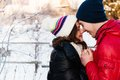 Portrait of young sensual couple in cold winter wather outdoor fashion love and kiss Stock Photo