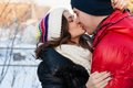 Portrait of young sensual couple in cold winter wather outdoor fashion love and kiss Stock Images