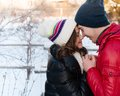 Portrait of young sensual couple in cold winter wather outdoor fashion love and kiss Royalty Free Stock Images