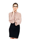 Portrait of the young serious woman in glasses and beige shirt with black skirt isolated on white background Stock Photography