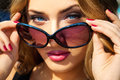 Portrait of young sexy beautiful girl with blue eyes and sunglas Royalty Free Stock Photo