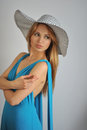 Portrait of young sexy blond girl wearing summer ha hat and blue dress Stock Photography