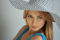 Portrait of young sexy blond girl wearing summer hat and blue dress Royalty Free Stock Photo
