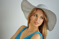 Portrait of young sexy blond girl wearing summer hat and blue dress Royalty Free Stock Photos