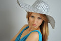 Portrait of young sexy blond girl wearing summer hat and blue dress Stock Photography
