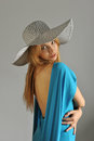 Portrait of young sexy blond girl wearing summer hat and blue dress Stock Images