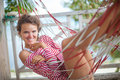 Portrait young sexy girl relaxing on beach Bungalow in hammock. Smiling woman spending chill time outdoor summer Royalty Free Stock Photo