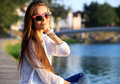 Portrait of young smiling beautiful woman close up portrait of a fresh and beautiful young fashion model posing outdoor summer Stock Photo