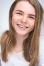 Portrait of young smiling happy teenager girl over gray background vertical shot Stock Images
