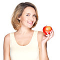 Portrait of a young smiling healthy woman with apple red isolated on white Stock Photography