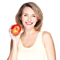 Portrait of a young smiling healthy woman with apple red isolated on white Royalty Free Stock Photo