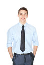 Portrait of young smiling successful businessman handsome standing with hands in pockets isolated on white background Royalty Free Stock Images