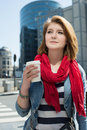 Portrait of a young smiling woman drinking coffee from a paper m enjoying hot drink mug against cityscape background Stock Images