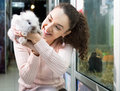 Portrait of young smiling woman holding fluffy animal