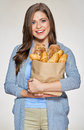 Portrait of young smiling woman holding paper bag with bread. Royalty Free Stock Photo