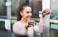 Portrait of young smiling woman holding turtles