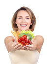 Portrait of a young smiling woman with a plate of vegetables isolated on white Stock Photo