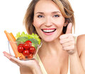 Portrait of a young smiling woman with a plate of vegetables isolated on white Stock Photography