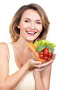 Portrait of a young smiling woman with a plate of vegetables isolated on white Stock Images