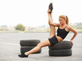 Portrait of young sporty woman doing stretching exercise athlet athletic workout Royalty Free Stock Photo
