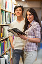 Portrait of young students holding a book Stock Photos