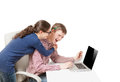 Portrait of young students laughing behind laptop Royalty Free Stock Photo