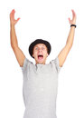 Portrait of young successful man cheering and raising him hands up Royalty Free Stock Photos