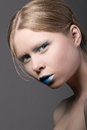 Portrait of young surprised girl close up with unusual blue make up Royalty Free Stock Photo