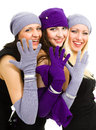 Portrait young three women white knit wool hat mittens isolated white background Stock Photography