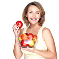 Portrait of a young woman with apples isolated on white Royalty Free Stock Photography
