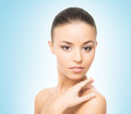 Portrait of a young woman on a blue background close up spa beautiful and healthy girl over Royalty Free Stock Images