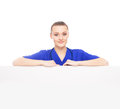 Portrait of a young woman in a blue shirt professional and cheerful female doctor standing over big blank billboard isolated on Stock Photo